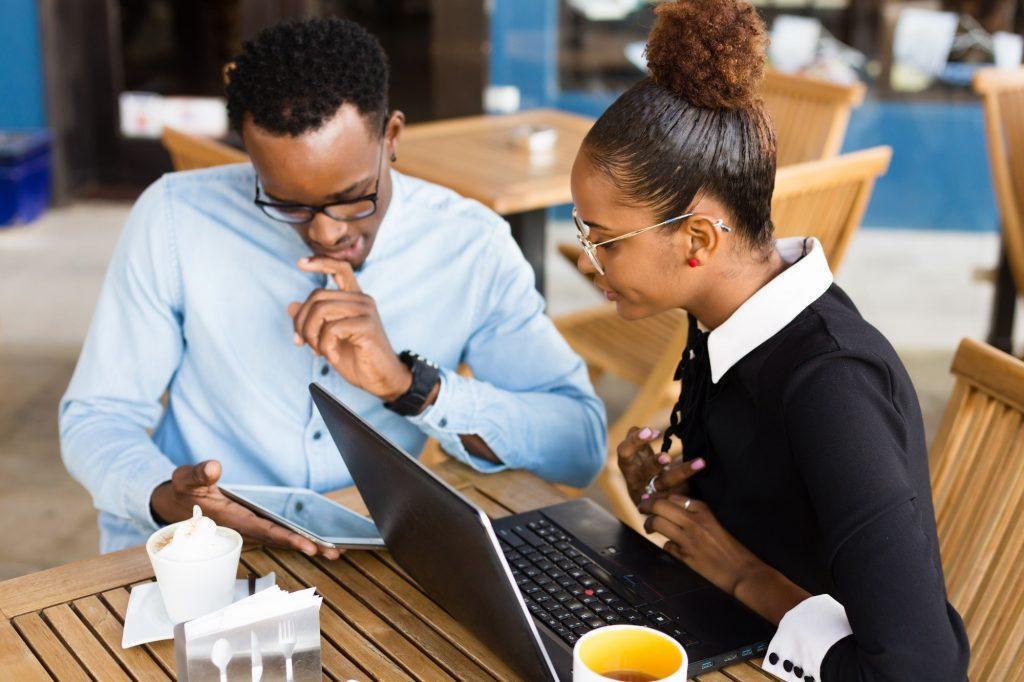 Black African American coworkers doing digital teamwork arround