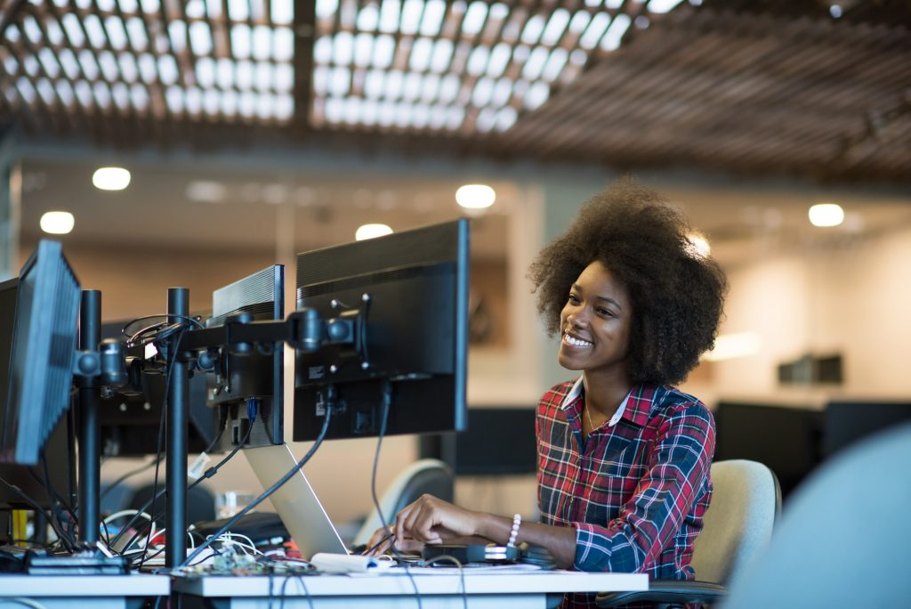 young black woman at her workplace in modern office